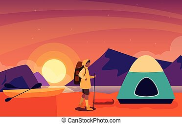 man with camping tent on the river shore