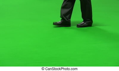Man with cane isolated on green