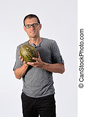 man with cantaloupe on white background