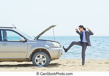 Man with car on seaside