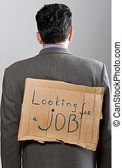 man with cardboard sign Looking job