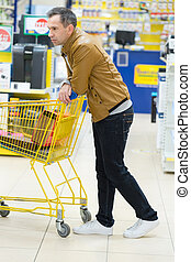 man with cart in a store