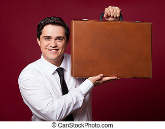 Man with case at red background