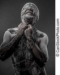 man with chains and blindfolded concept of prison, without freedom