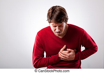 Man with chest pain - Young man with strong chest pain,...