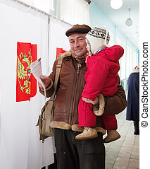 Man with child votes in Russian presidential election