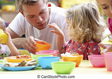 Man with children playing together
