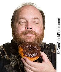 Man with chocolate donut