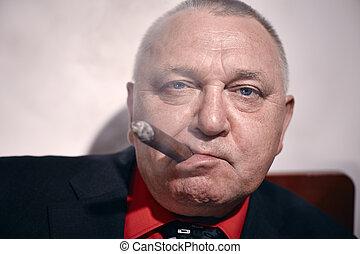 Man with cigar closeup
