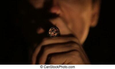 Man with cigar.
