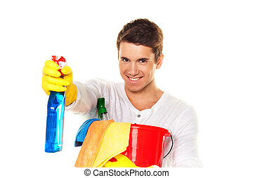 man with cleaning fluid. cleaning the apartment. hausmannbei apartment cleaning in the spring