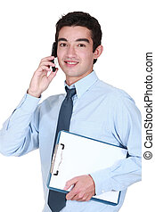 Man with clip-board making an important call
