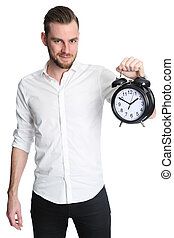 Man with clock smiling - An attractive man wearing a white...