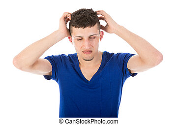 Man with closed eyes and hands at his head