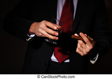 Man with cognac and cigar