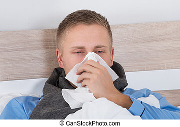 Man With Cold Blowing Her Nose