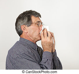Man With Cold Sneezing - Man with bad cold or flu sneezing...
