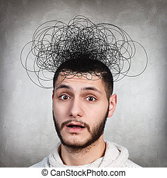 Man with confusing tangle of thoughts