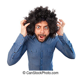 Man with crazy expression and puffy hair on white background...