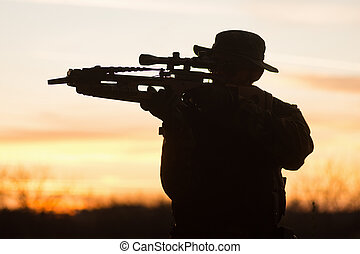 man with crossbow silhouette