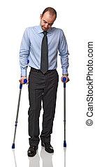 man with crutch - businessman man walking with crutch...