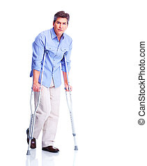 Man with crutch. Isolated on white background.