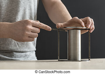 Man with cylindrical metal construction