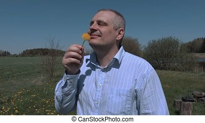 Man with dandelion at dandelion meadow