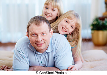 Man with daughters