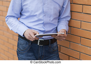 Man with digital tablet in hands.