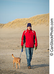 Man with dog at the beach