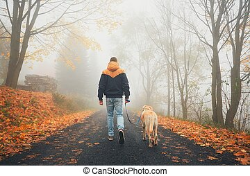 Man with dog in autumn nature
