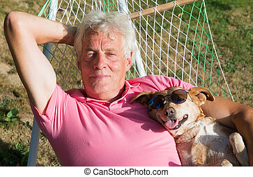 Man with dog in hammock