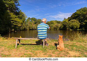 Man with dog in nature