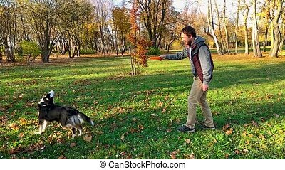 Man with dog in park