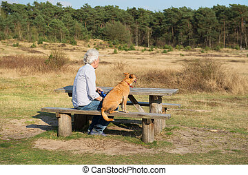Man with dog - landscape with man and dog at the wooden...