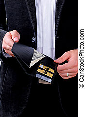 man with dollars and credit cards - man holding a wallet ...