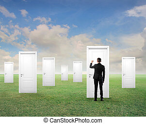 man with doors - businessman turned his back knocking on the...