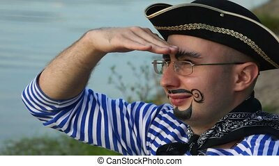 man with drawed beard and moustaches in pirate costume and...