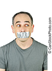 Man with duct tape on mouth - Portrait of man with duct tape...