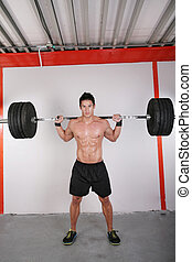 Man with dumbbell weight training equipment on sport gym