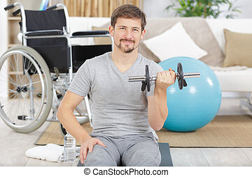 man with dumbbells at home