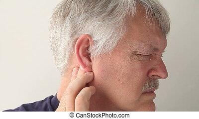 man with earache