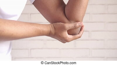 man with elbow pain isolated in white. Pain relief concept