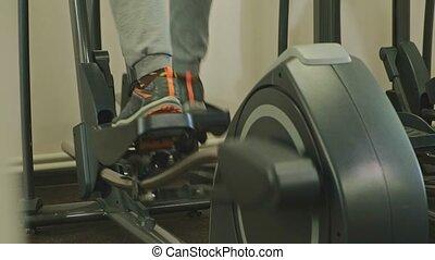 man with elliptical machine in the gym.