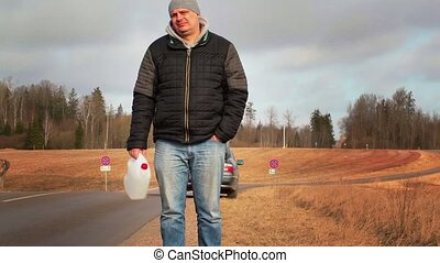 Man with empty can waiting for help