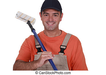 Man with extended paint roller