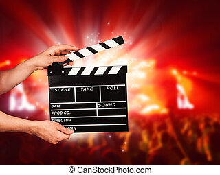 Man with film clapper on concert - Man hands holding film ...