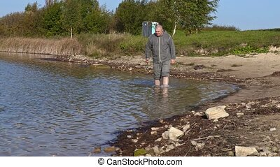 Man with fishing rod on the shore