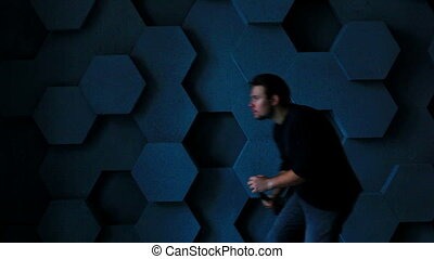 Man with flashlight in dark room.